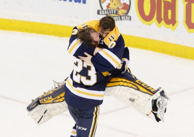Wayzata goalie Alex Schilling, top, jumps into the arms of teammate Hank Sorenson after the Trojans came from behind to defeat Eden Prairie 5-3 in the Class 2A championship game of the State Boys Hockey Tournament at Xcel Energy Center in St. Paul on Saturday, March 5, 2016. (Pioneer Press: Holly Peterson)